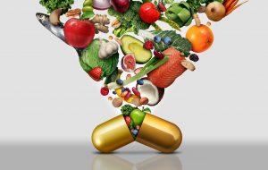 vitaminer i form av frukt og grønt i kapsel